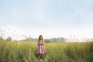 Girl standing in rural field - HEROF10777