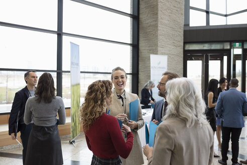 Business people networking at conference - HEROF11026