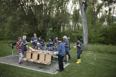Volunteers enjoying pizza in park - HEROF11113