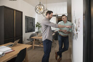 Home builder architect and designer planning at wall in office - HEROF11629