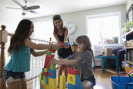 Girl friends playing with building blocks - HEROF11707