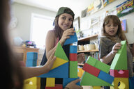 Girl friends playing with building blocks - HEROF11710
