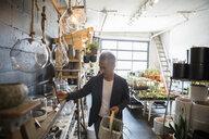 Mature man shopping in plant shop - HEROF11863