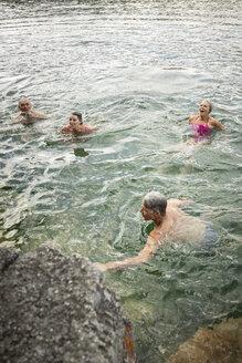 Mature couples swimming in lake - HEROF11986