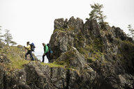 Active senior couple backpacking on cliff trail - HEROF12016