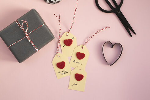 Valentine gift and self-made tags on pink background - MOMF00607