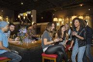 Friends laughing at bar - HEROF12124