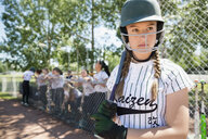 Focused middle school girl softball player preparing in batter - HEROF12259