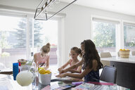 Girls coloring at dining table - HEROF12313
