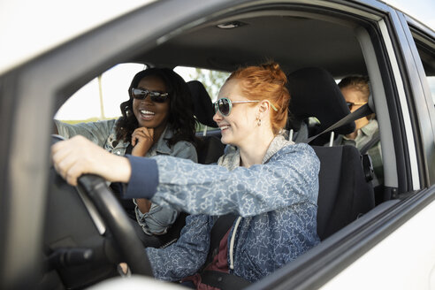 Smiling young women friends in car, enjoying road trip - HEROF12628