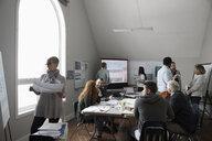 City planners and volunteers meeting in office - HEROF12778
