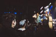 Crowd cheering, enjoying music concert in nightclub - HEROF12811