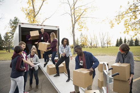 Volunteers loading cardboard boxes onto truck - HEROF13051