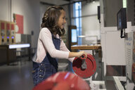 Smiling girl, at interactive exhibit in science center - HEROF13096