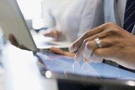 Close up businessman using digital tablet - HEROF13105
