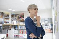 Businesswoman brainstorming at board in office - HEROF13117