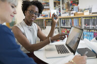 Businesswomen working at laptop in office - HEROF13120