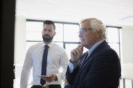 Businessmen with digital tablet planning in conference room - HEROF13126