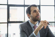 Businessman with beard listening in meeting - HEROF13165