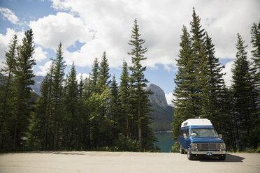 Camper van parked at remote mountain lakeside - HEROF13303