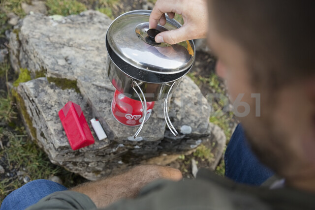 Close up man cooking with camping stove - HEROF13312