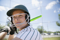 Middle school girl softball player ready to bat - HEROF13339