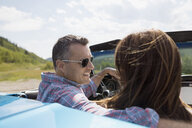 Mature couple in convertible - HEROF13483