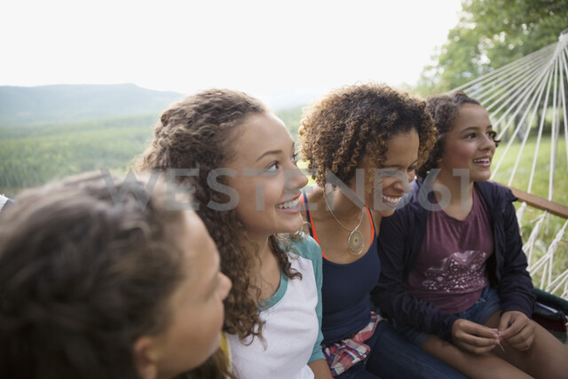 Mother and daughters sitting in hammock - HEROF13498