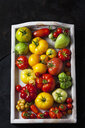 Wooden tray of various sorts of tomatoes - CSF29266