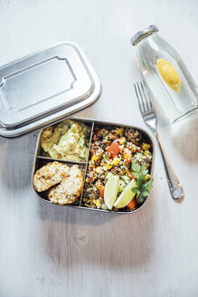 Bento box of quinoa salad with vegetables and lime, avocado cream and cauliflower dumplings - IPF00495