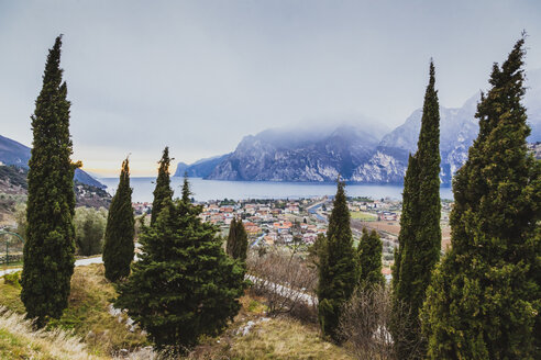 Italy, Trentino Alto-Adige, Nago-Torbole, view of the city facing Garda Lake on a cold winter day - FLMF00124