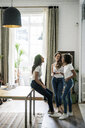 Three happy women socializing at home - GIOF05674