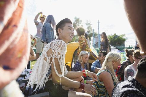 Smiling young man enjoying summer music festival - HEROF13571