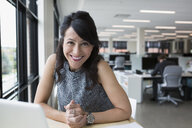 Portrait smiling businesswoman in office - HEROF13721