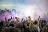 Powder over dancing crowd at summer music festival - HEROF13757