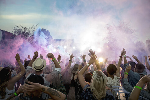 Powder over dancing crowd at summer music festival - HEROF13757