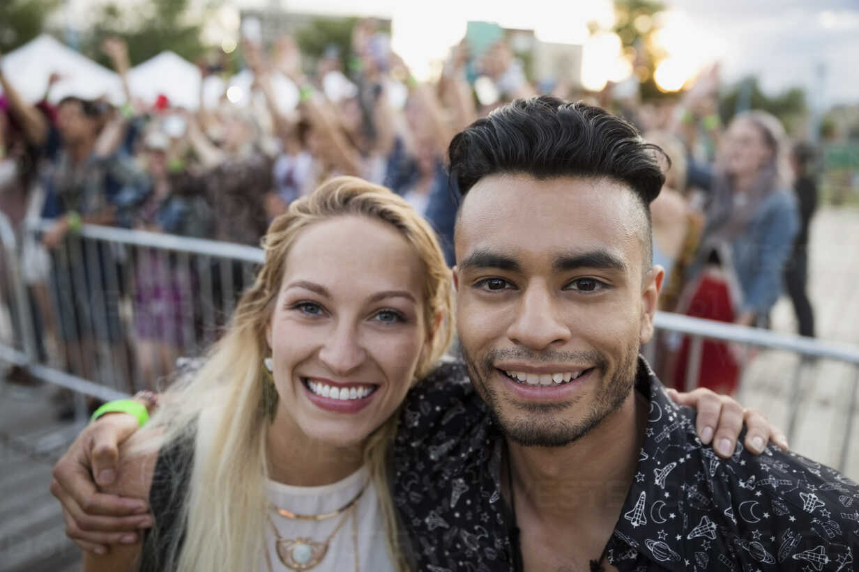 Portrait smiling young couple at summer music festival - HEROF13778 - Hero Images/Westend61