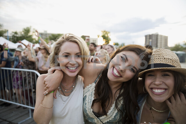 Portrait enthusiastic young women at summer music festival - HEROF13967