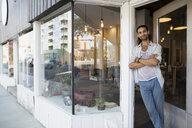 Portrait confident male shop owner in storefront doorway - HEROF14021