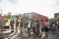 Young crowd in queue at summer music festival entrance - HEROF14072
