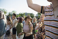 Young women in crowd enjoying summer music festival - HEROF14090