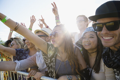 Young crowd cheering at summer music festival - HEROF14093