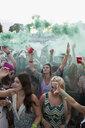 Young women cheering in powder crowd at summer music festival - HEROF14111