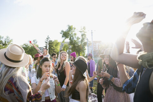 Young friends dancing and hanging out at summer music festival - HEROF14132