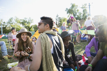Young friends hanging out at summer music festival campsite - HEROF14135