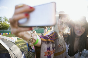 Young women taking selfie at summer music festival campsite - HEROF14138