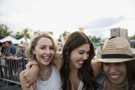 Young women laughing at summer music festival - HEROF14147