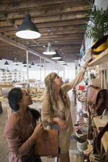 Women friends shopping browsing in shop - HEROF14234