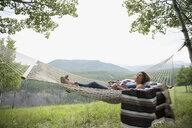 Woman relaxing in rural hammock - HEROF14285