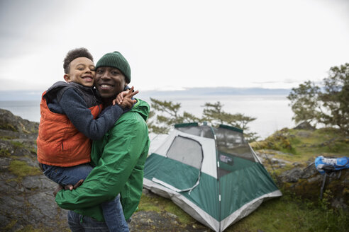 Portrait affectionate father and son camping - HEROF14435